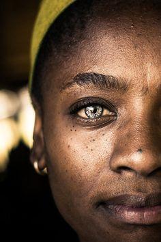 The fruit vendor's eyes . Soweto, Johannesburg