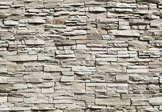 Fotomural Wizard Genius The Wall 143, fotomural de un muro de piedra en tonos de grises y beige.