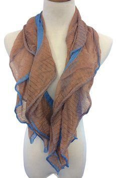 This is a 100% Rayon Missoni scarf. It is made from a thin sheer material that adds a great flare to your outfit. The colors go well with each other, which make the scarf versatile with most outfits. In good condition. TR