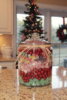Kitchen Candy Jar I get so many comments on this island centerpiece. Here is the secret- I placed a smaller jar upside down in the middle of the large jar and filled the candy in the space between the two jars. It takes A LOT less candy to fill that way! AND....I reuse the same candy every year! so there is no temptation! Merry Christmas from the Kerns Family  Photos by Dana Laymon Photography http://danalaymonphotography.com