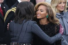 First Lady Michelle Obama (left) greets Beyoncé after the singer performed the National Anthem during the inauguration for President Barack Obama on January 21, 2013