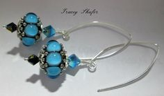 Handmade Glasswork beads by Tom Gronwall, Vintage Swarovski & Sterling Silver Wires made by me. Sterling Silver findings.