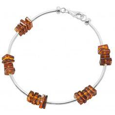 Bracelet en Argent 925/1000 et pierre d'ambre rectangulaire (cognac). Poids approximatif:5.1 grammes. Diamètre approximatif:18 cm Dimension des pierrestotal: 1cm