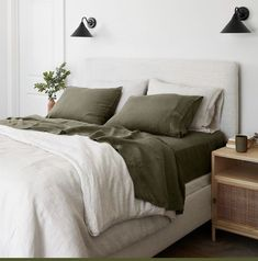 good example of hoe to possible wall sconces with bed and side table/shelf. Also, like the pillow formation. Bedroom Apartment, Home Bedroom, Apartment Living, Bedroom Green, Dream Bedroom, Olive Bedroom, Green Bedrooms, Green Bedding, Green Pillows