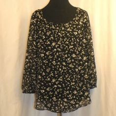 Lauren Conrad Floral Top Sheer 5 button top with black & white floral print. 100% Polyester. LC Lauren Conrad Tops Blouses