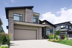 Modern homes are all about clean lines, strong angles, and horizontal design elements. When it comes to choosing a modern garage door, look at these same characteristics. Modern Style Homes, Modern Tiny House, Modern House Design, Contemporary Design, Garage To Living Space, Carriage Garage Doors, Modern Garage Doors, Bookshelves In Bedroom, Modern Sink