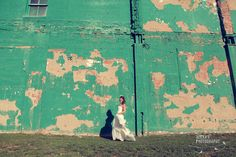 Bride in front of chipping green wall... Durham, NC