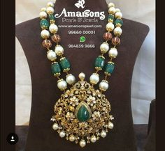 Gorgeous in green! Beauty and royalty comes together in this combination tar mala. Beautiful long haaram with floral design large pendant. Pendant with pearl hangings. Get in touch with Amarson to own this masterpiece! Beaded Jewelry Designs, Gold Earrings Designs, Gold Jewellery Design, Bead Jewellery, Jewelry Patterns, Pendant Jewelry, Pendant Set, Necklace Designs, Diamond Pendant