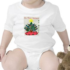 Baby's 1st Christmas and Be Merry is written on this lovely T-shirt Baby Bodysuit.  Pretty, old-fashioned Christmas tree decorated with colorful ornaments, garland and a bright yellow star on top, with the background cross stitch look.  Joy is written on the red tree skirt with holly leaves and berries around the border. PERSONALIZE.  Available in shirt sizes/styles baby to adults.  Graphic Art Digital Painting Design by TamiraZDesigns at:  www.zazzle.com/tamirazdesigns*