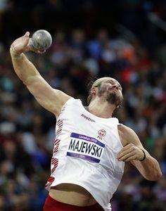 Poland's Tomasz Majewski competes in the men's shot put final during the athletics competition in the Olympic Stadium at the 2012 Summer Olympics, Friday, Aug. 3, 2012, in London.