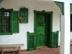 Traditional Hungarian wooden shutters for doors and windows - Flooring Piclodge Cottage Exterior, Interior And Exterior, Cordwood Homes, Transition Flooring, Old Country Houses, Playground Flooring, Wooden Shutters, Arched Windows, Wooden House