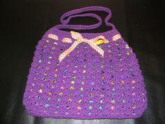 Purple Purse made of cotton yarn. Bright cotton liner inside.