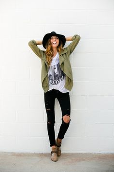 distressed black jeans + army jacket + band tee