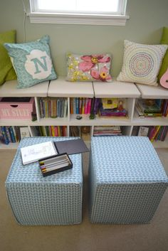 DIY simple reading nookreading nook title with words. Turning some bookshelves sideways and adding some cozy pillows is all that was needed to create a simple window seat. This reading nook in a girls bedroom is sugar, spice and everything sweet about a little girls bedroom.