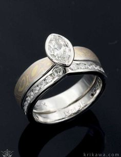 Classic and unique, this Mokume Solitaire Tapered Engagement Ring was done in our Trigold Mokume Gane with a marquise cut diamond solitaire and a contoured diamond channel wedding band to complete the set! Design your own in the metal, mokume and stones you love most!