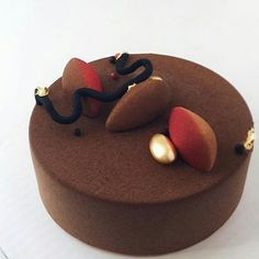 pastryinspirationschool.com @pastry_inspiration @ksenia.penkina: Detalization for today: Cake is covered by perfectly made chocolate velvet, decorations are made with mousse figures, chocolate branch, crisps, golden almonds & edible golden flakes. All edible, including the cake 😜✌🏻️ #moussecake #vancouver #chocolatevelvet #муссовыйторт