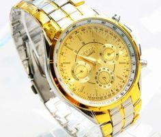 Luxusné pánske hodinky Rosra v zlato striebornej farbe. Sleduje svoj čas štýlovo s týmito luxusnými hodinkami v zlato striebornej farbe. Hodinky Rosra Vás uchvátia svojim vkusným, elegantným a nadčasovým dizajnom. Telo hodiniek je pozlátené 18K zlatom. Pokiaľ chcete spestriť svoj outfit a sledujete aktuálne módne trendy, tieto hodinky sú určené práve pre Vás. Malé ciferníky sú v zlatej farbe a slúžia len ako dekorácia hodiniek. http://www.luxusne-doplnky.eu/