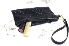 Black clutch with delicate punch-out detailing. Perfect for spring!