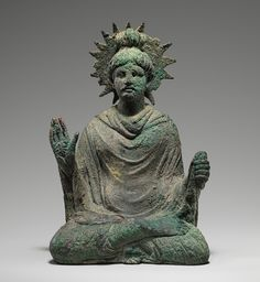 Seated Buddha, 1st–mid-2nd century a.d. Pakistan, ancient region of Gandhara. Bronze with traces of gold leaf.