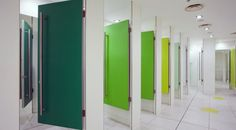 Topshop' store used Formica® High Pressure Laminate with an impactful colour scheme for the doors: greens, blues, yellows, reds and pinks in a rainbow colours