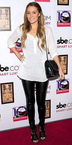 White blouse over leather leggings