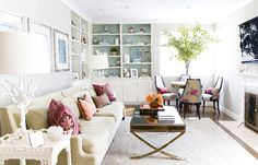 Erinn V Design Group: Chic living room with soft gray walls paint color, modern sofa, white coral lamps, white ...