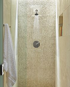 love the feature shower wall with stone texture