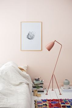 Soft pink walls and white floors create a calming and bright setting for a sunny interior look.