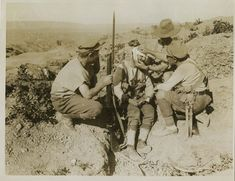 Photograph of three ANZAC soldiers attending to wounded comrade. No 5227. From a collection of official photographs of the Dardanelles Expedition, 1915.