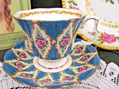 OFFERING THIS PRETTY JUST FANTASTIC TEA CUP AND SAUCER MADE BY ROYAL ALBERT SUPER DESIGN AND COLOR THIS PATTERN IS CALLED KENILWORTH MADE OF A FINE BONE CHINA WITH NO WEAR AND NO FADING AND NO CRAZING, SUPER DESIGN AND COLORS, NICE CHINTZ PATTERN AND SUPER PINK ROSES MARKED AS SHOWN
