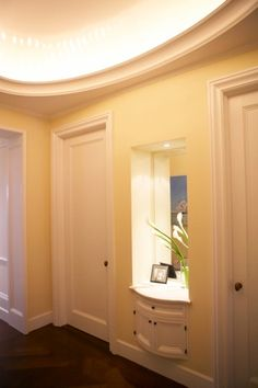 Entry foyer niche cabinet and elliptical cove.