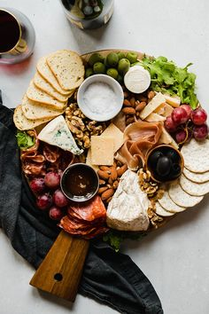 How to Make a Cheese Plate - with step by step instructions and photos! It's easy to make a gorgeous cheese plate presentation with a few simple ideas. This holiday (or any day!) appetizer can be made vegetarian or rounded out with meat, sausage, and other charcuterie. Use grapes, figs, herbs, and any of your other favorite snacks to make an ultimate cheese board in just a few minutes! Includes options to make it ahead of time.