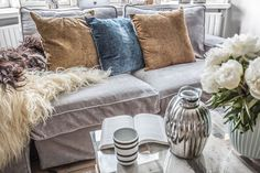 the minimal layered boho living room of fashion blogger Simone Moelle | Beni ourain rug and crate coffee table | grey velvet sofa and chaise | IKEA Kivik sofa and chaise longue with Bemz covers in Zinc Zaragoza Vintage velvet from our collaboration with Designers Guild