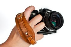 Handy Dandy Hand Strap - A stylish leather hand strap that keeps your finger by the shutter and your arms totally ripped. ($40.00, http://photojojo.com/store)