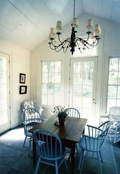 Dining Room with Vaulted Wood Ceiling. Featured in the December 2009 Issue of Cottage Living. Classic White House. Metal Roof. Jeffersonian. New house designed to look old. Steven Gambrel