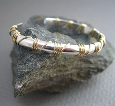 Sterling Medium Cuff wrapped in 14kt.  gold filled wire, Mixed Metal Artisan Bracelet Handcrafted Jewelry. $72.00, via Etsy.