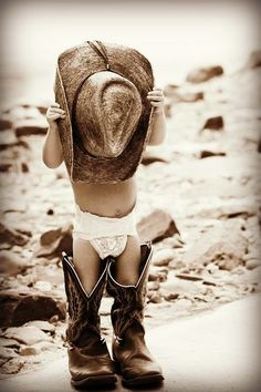 Little cowboy and daddy's cowboy boots - this is the basic premise I want for a tattoo for my stepdad. Little girl, with long hair flowing down from behind the cowboy hat in front of her face, and cowboy boots that are way too big. No diaper, though haha