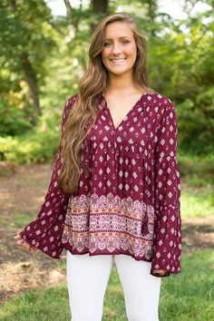 If you're anything like us, you simply can't get enough of the boho vibes. Lucky for you, this burgundy colored long bell sleeve top by En Creme has just enough bohemian flair to satisfy your hearts c