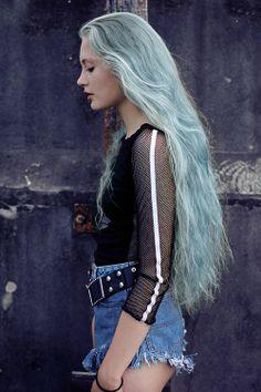 Pale cloud blue hair. Sea-tossed waves.