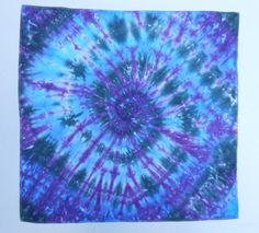 Awesome swirl bandana with a blend of blues, black, and purple.
