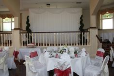 Fairy light back drop with topiary trees in the banqueting hall
