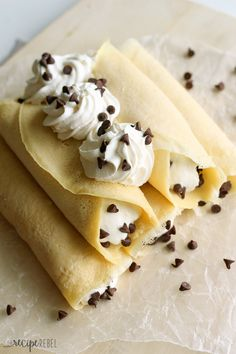 Cannoli Crepes: Soft homemade crepes filled with sweet ricotta cream and chocolate chips, topped with whipped cream and more chocolate chips. A breakfast version of an Italian favorite! Click through for recipe!