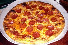Thin-crust pizza from Darcy's Village Pub, a bar on Willard Street in Quincy, MA. (from http://hiddenboston.com/foodphotos/darcys-thin-crust-pizza.html) #pizza