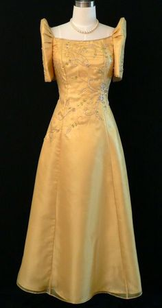 Lol, I'll get my mom to wear the mestiza dress. Traditional Filipiana gown!