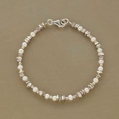 SIDE BY SIDE BRACELET -- Cultured pearls bring their luminous glow to the glimmering juxtaposition of sterling silver squares and spheres. Pearl Bracelet, Pearl Jewelry, Wire Jewelry, Jewelry Crafts, Beaded Jewelry, Jewelery, Silver Jewelry, Diy Bracelet, Silver Bracelets