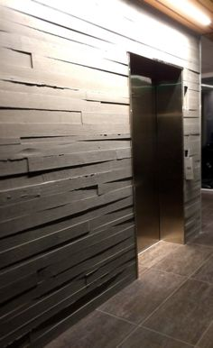 Beautiful board form concrete walls by Concrete-Visions surround the elevator at Fransen-Pittman's new Englewood, CO office.