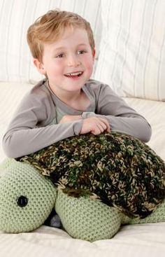 Turtle Pillow Pal Crochet Pattern Here's a wonderful crocheted turtle for your favorite kid to hug and love. It's stuffed with a standard size pillow so it's perfect for naptime or keeping a child company when visiting relatives. Red Heart Free Pattern - no membership required