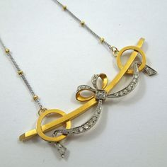18k White & Yellow Gold Vintage Bow Pin with Diamond Accents Converted into a Necklace. $975
