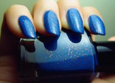 Barielle Falling Star - a slightly dusty medium blue creme/jelly with orange glitter. Click the image for more!