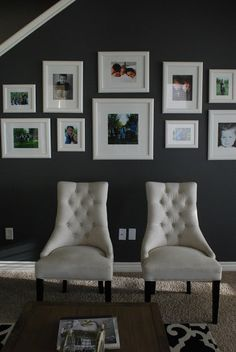 Love the idea - colour photos in white frames with white borders on a dark wall